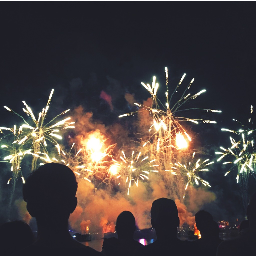 silhouetted-people-watching-a-fireworks-display-picture-id929264972 (2)-1